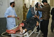 Pakistani paramedics treat an injured blast victim at a hospital following a bomb attack in Quetta on January 10, 2013. It was one of the worst single attacks ever on the minority community, which account for around 20 percent of Pakistan's 180-million strong population