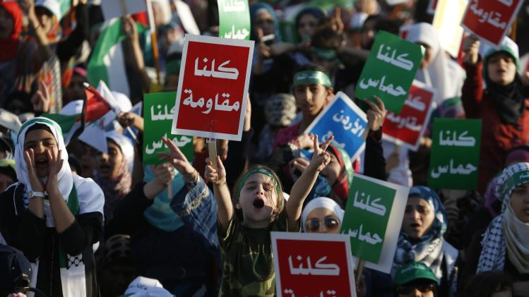 Supporters of the Jordanian Muslim Brotherhood take part in a rally in Amman