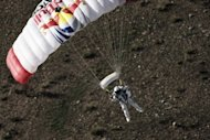 Austrian athlete Felix Baumgartner lands in the desert during the second manned test flight for Red Bull Stratos in Roswell, New Mexico, in July. Strong winds forced Baumgartner to abort his attempt Tuesday at a record-breaking leap to Earth from the edge of space