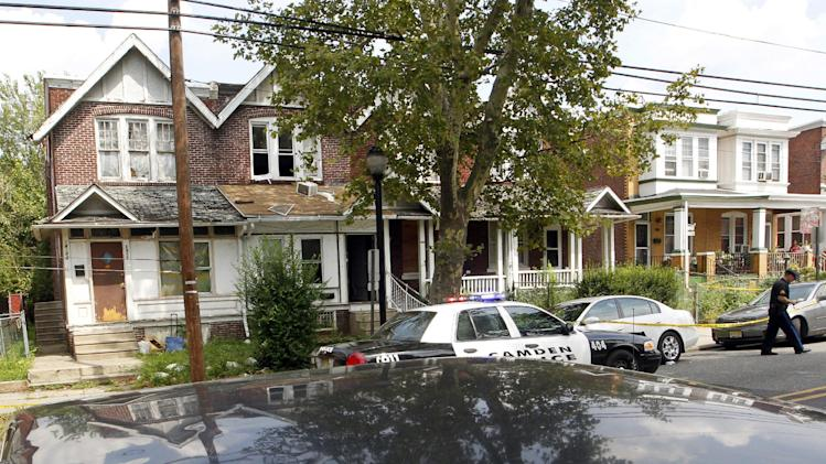"""An air conditioner rests on a porch roof, second from left, at 1415 Kaighn Ave., in Camden, N.J., Wednesday, August 22, 2012, after police in Camden say a 2-year-old boy was decapitated, apparently by his mother, and his head left in the freezer of their home before woman fatally stabbed herself. Chevonne Thomas, 33, called 911 just after midnight to say something had happened to her child and it """"sounded like she had done it,"""" Camden County Prosecutor's Office spokesman Jason Laughlin said. Officers found Zahree Thomas' body on the first floor of the home on Kaighn Avenue and the boy's head in the freezer. (Photo/Mel Evans)"""