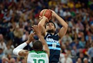 Argentinian guard Carlos Delfino tries to shoot past Brazilian guard Leandrinho Barbosa during their London 2012 Olympic Games men's quarterfinal basketball match in London