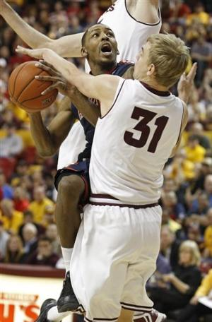 No. 7 Arizona outlasts Arizona State 71-54