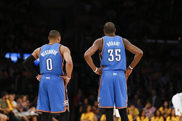 Oklahoma City Thunder point guard Russell Westbrook and Oklahoma City Thunder small forward Kevin Durant stand together on the court against the Los Angeles Lakers during the second half of an NBA bas