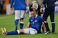 Italian defender Giorgio Chiellini asks for medical assistance during the Euro 2012 football championships match Italy vs Republic of Ireland on June 18, 2012 at the Municipal Stadium in Poznan.    AFP PHOTO / GIUSEPPE CACACE