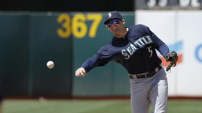 Seattle Mariners shortstop Brad Miller (5) throws to first after forcing out Oakland Athletics' Billy Burns (1) at second base on a double play hit into by A's Stephen Vogt during the sixth inning of a baseball game in Oakland, Calif., Sunday, July 5, 2015. (AP Photo/Jeff Chiu)