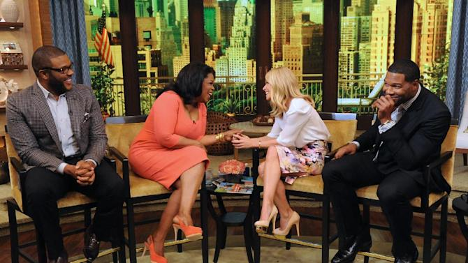 """This image released by Disney-ABC Domestic Television shows actor-director-producer Tyler Perry, left, with Oprah Winfrey, and co-hosts Kelly Ripa, second right, and Michael Strahan, right, on """"Live with Kelly and Michael,"""" on Tuesday, May 28, 2013 in New York. (AP Photo/Disney-ABC Domestic Television, David Russell)"""