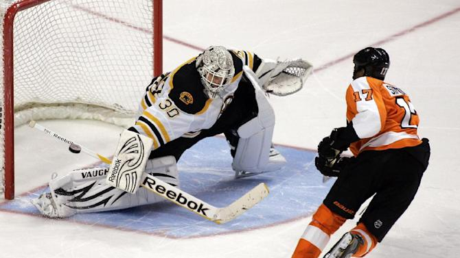 Boston Bruins goalie Tim Thomas (30) makes a stick save on a shot by Philadelphia Flyers' Wayne Simmonds (17) during an overtime shootout in an NHL hockey game on Sunday, Jan. 22, 2012, in Philadelphia. The Bruins won 6-5. (AP Photo/Tom Mihalek)