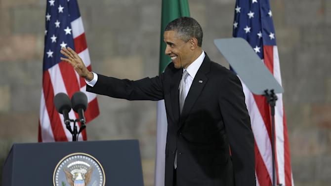 President Barack Obama waves as he arrives to speak at the Anthropology Museum in Mexico City, Mexico, Friday, May 3, 2013.  Obama said he is optimistic that the U.S. will change its patchwork of immigration laws and that the current immigration system does not reflect U.S. values. With about 6 million Mexicans illegally in the United States, the issue resonates deeply in Mexico, which has also seen deportations of its citizens from the U.S. rise dramatically under Obama. (AP Photo/Dario Lopez-Mills)