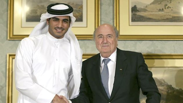 FIFA President Sepp Blatter (R) shakes hands with Qatar's 2022 World Cup Bid Chief Sheikh Mohammed Al-Thani (L) at a news conference in Doha November 9, 2013. (Reuters)