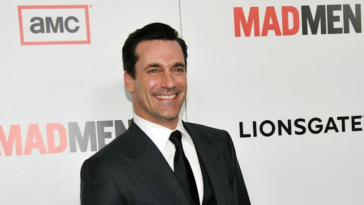 "FILE - In this March 20, 2013 file photo, ""Mad Men"" star Jon Hamm poses at the season six premiere of the drama series at the Directors Guild of America, in Los Angeles. Hamm says he's ""fine"" despite an upcoming procedure to remove a polyp on his vocal cord.""It's a simple injury,"" said a raspy sounding Hamm in an interview Thursday, Sept. 26, 2013. (Photo by Chris Pizzello/Invision/AP, File)"