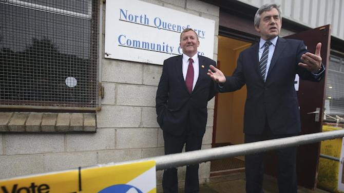 Britain's former Prime Minister Gordon Brown gestures outside the polling station at North Queensferry Community Centre, in Queensferry, Scotland, Thursday, Sept. 18, 2014. Polls opened across Scotland in a referendum that will decide whether the country leaves its 307-year-old union with England and becomes an independent state. (AP Photo//PA, Andrew Milligan) UNITED KINGDOM OUT