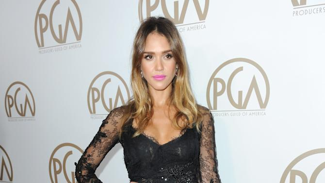 IMAGE DISTRIBUTED FOR THE PRODUCERS GUILD - Jessica Alba arrives at the 24th Annual Producers Guild (PGA) Awards at the Beverly Hilton Hotel on Saturday Jan. 26, 2013, in Beverly Hills, Calif. (Photo by Jordan Strauss/Invision for The Producers Guild/AP Images)