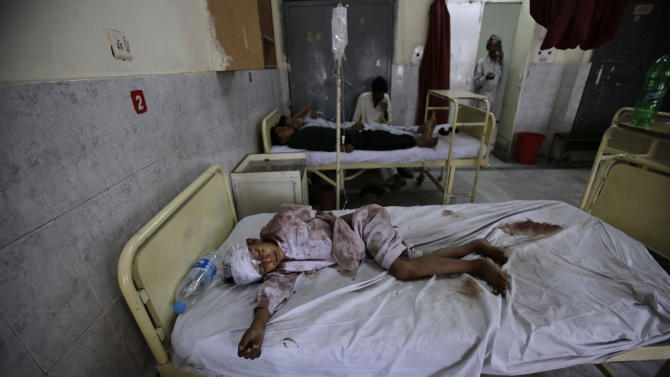 Pakistani boy Aqeel Arshae, 8, who was severely injured in the head in a bus accident, lies in a bed in Benazir Bhutto hospital, in Rawalpindi, Pakistan, Monday, June 4, 2012. At least 25 members of a wedding party died early Monday when their bus fell into a deep ravine, in the Pakistani town of Kahuta near Rawalpindi, police said. (AP Photo/Muhammed Muheisen)