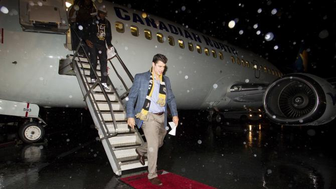 Quarterback Zach Collaros of the Hamilton Tiger-Cats arrives at the Vancouver International Airport prior to the 102nd Grey Cup game in Vancouver