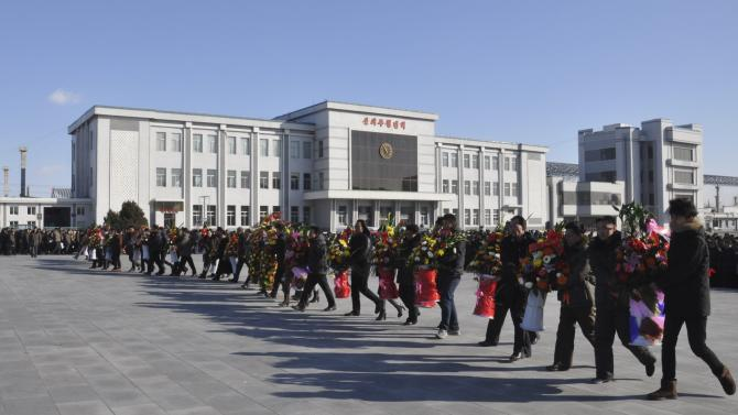 North Korean pay respects to mark the third anniversary of the death of former leader Kim Jong Il in Pyongyang