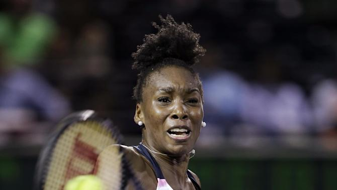 Venus Williams returns a shot from Kimiko Date-Krumm, of Japan, during the Sony Open tennis tournament, Thursday, March 21, 2013 in Key Biscayne, Fla. Williams won 7-6 (3) 3-6, 6-4. (AP Photo/Wilfredo Lee)