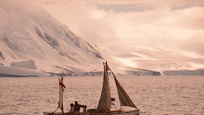 "In this Jan. 23, 2013 photo released by Shackleton Epic, adventurers aboard their boat Alexander Shackleton cross the Southern Ocean. A modern-day team of six led by Tim Jarvis and Barry ""Baz"" Gray used similar equipment and clothes to re-enact a 1916 expedition led by Ernest Shackleton to save his crew after their ship got stuck in Antarctica's icy waters. They reached an old whaling station on remote South Georgia island Monday, Feb. 11, 2013, 19 days after leaving Elephant Island. Just as Shackleton did in 1916, Jarvis and his team sailed 800 nautical miles across the Southern Ocean in a small lifeboat and then climbed over crevasse-filled mountains in South Georgia. (AP Photo/Shackleton Epic, Si Wagen)"