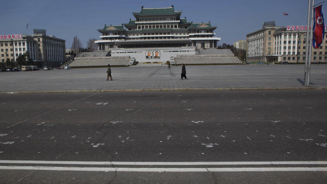 A grid of dots and numbers, painted so citizens know where to stand during mass political events, cover the street in front of Kim Il Sung Square in Pyongyang on Friday, April 12, 2013. (AP Photo/David Guttenfelder)