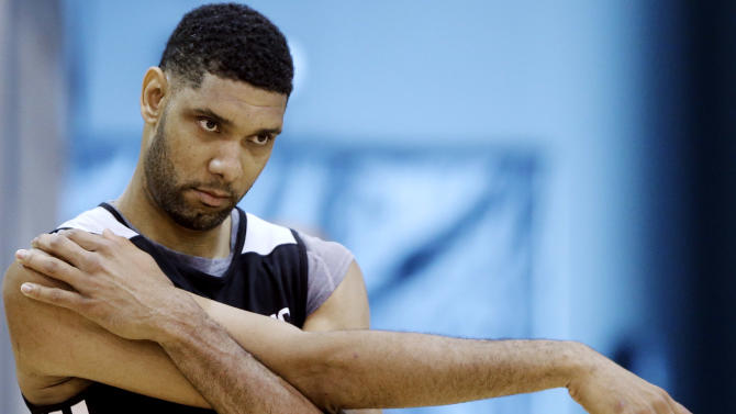 San Antonio Spurs forward Tim Duncan stretches during practice on Saturday, June 7, 2014, in San Antonio. The team plays Game 2 of the NBA Finals against the Miami Heat on Sunday