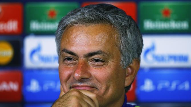 Chelsea's manager Jose Mourinho smiles during a news conference in Cobham