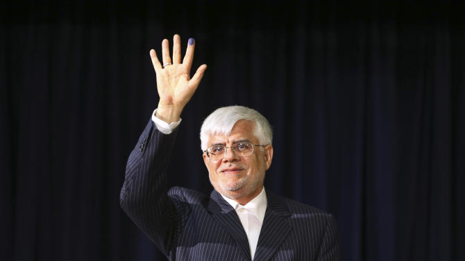 In this photo taken on Friday, May 10, 2013, pro-reform former Iranian Vice-President Mohammad Reza Aref, waves to media during his press conference, after registering his candidacy for the upcoming presidential election, at the election headquarters of the interior ministry in Tehran, Iran.  He was selected Tuesday, May 21, 2013 as one of eight candidates allowed to push ahead with his presidential bid. (AP Photo/Ebrahim Noroozi)