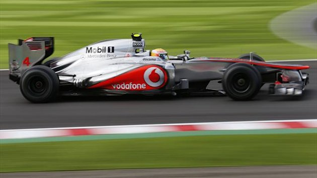 McLaren Formula One driver Lewis Hamilton of Britain drives during the qualifying session of the Japanese F1 Grand Prix at the Suzuka circuit (Reuters)