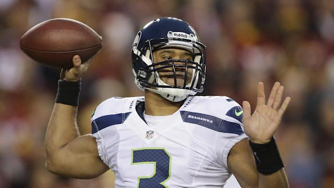 Seattle Seahawks quarterback Russell Wilson passes the ball during the first half of an NFL wild card playoff football game against the Washington Redskins in Landover, Md., Sunday, Jan. 6, 2013. (AP Photo/Matt Slocum)