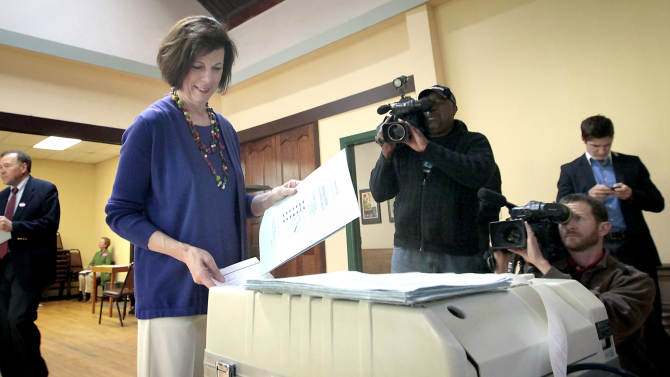 Wisconsin Democratic candidate for governor Kathleen Falk registers her vote in the state's primary recall election at the Wil-Mar Center in Madison, Wisconsin, Tuesday, May 8, 2012. Wisconsin voters filed into polling stations Tuesday to decide whether to give Milwaukee Mayor Tom Barrett a rematch against Republican Gov. Scott Walker in next month's rare recall election or whether to back one of Barrett's fellow Democrats.  (AP Photo/Wisconsin State Journal, John Hart)