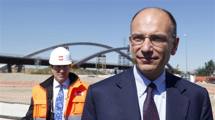Italian Prime Minister Enrico Letta arrives at the construction site of Expo 2015, on the outskirts of Milan