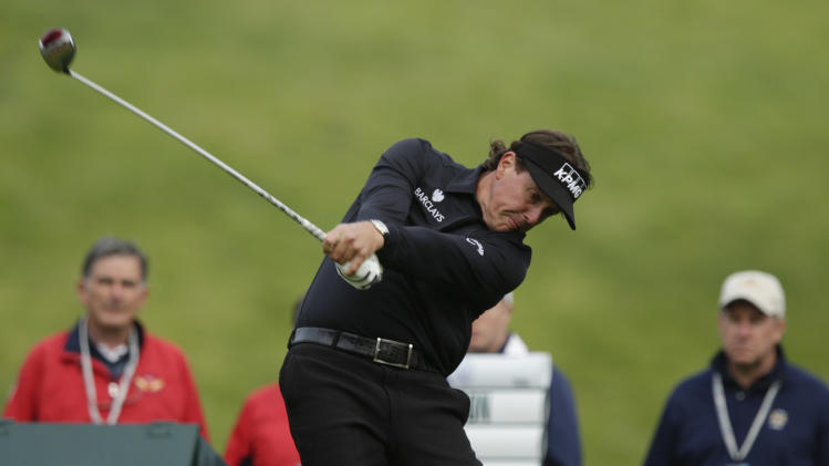 Phil Mickelson hits a drive on the ninth hole during the first round of the U.S. Open Championship golf tournament Thursday, June 14, 2012, at The Olympic Club in San Francisco. (AP Photo/Charlie Riedel)