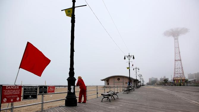 A red-flagged beach greets visitors to the Coney Island boardwalk as people await the arrival of Hurricane Irene at the Coney Island section of New York, Saturday, Aug. 27 2011. (AP Photo/Craig Ruttle)