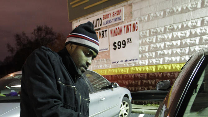 Vladimir Chery fills his tank with gasoline after waiting in a long line with his container in Brooklyn, where gas is still scarce, Thursday, Nov. 8, 2012, in New York.  Fuel shortages and distribution delays that led to gas hoarding have prompted New York City and Long Island to initiate an even-odd gas rationing plan which begins Friday at 6 a.m. in New York and 5 a.m. in Long Island. (AP Photo/Kathy Willens)