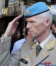 The UN&#39;s Syria mission leader Major General Robert Mood, pictured in Damascus on June 5, told the UN Security Council of the intensifying violence in the country but said the nearly 300 unarmed monitors were &quot;morally obliged&quot; to stay