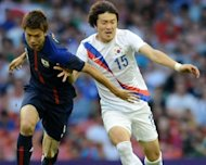 South Korea's Park Jong-Woo (R) and Japan's Takahiro Ohgihara during their bronze medal football match at the London Olympics on August 10. Park will be excused military service as a reward for his Olympic performance despite controversially displaying a sign on a territorial dispute, an official said