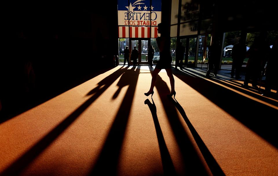 Shadows are cast across the floor as people pass by outside the debate hall ahead of the vice presidential debate with Republican vice presidential candidate, Rep. Paul Ryan, R-Wis., and Vice President Joe Biden, Thursday, Oct. 11, 2012, at Centre College in Danville, Ky. (AP Photo/David Goldman)