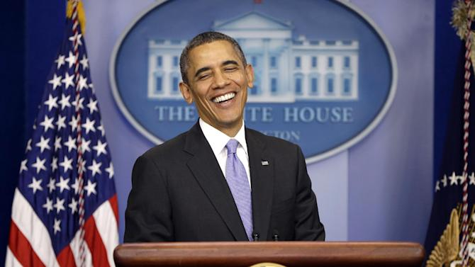 President Barack Obama smiles as he prepares to answer a question during an end-of-the year news conference in the Brady Press Briefing Room at the White House in Washington, Friday, Dec. 20, 2013. Obama will depart later for his home state of Hawaii for his annual Christmas vacation trip. It's the first time in his presidency that his departure plans have not been delayed by legislative action in Washington. (AP Photo/Pablo Martinez Monsivais)