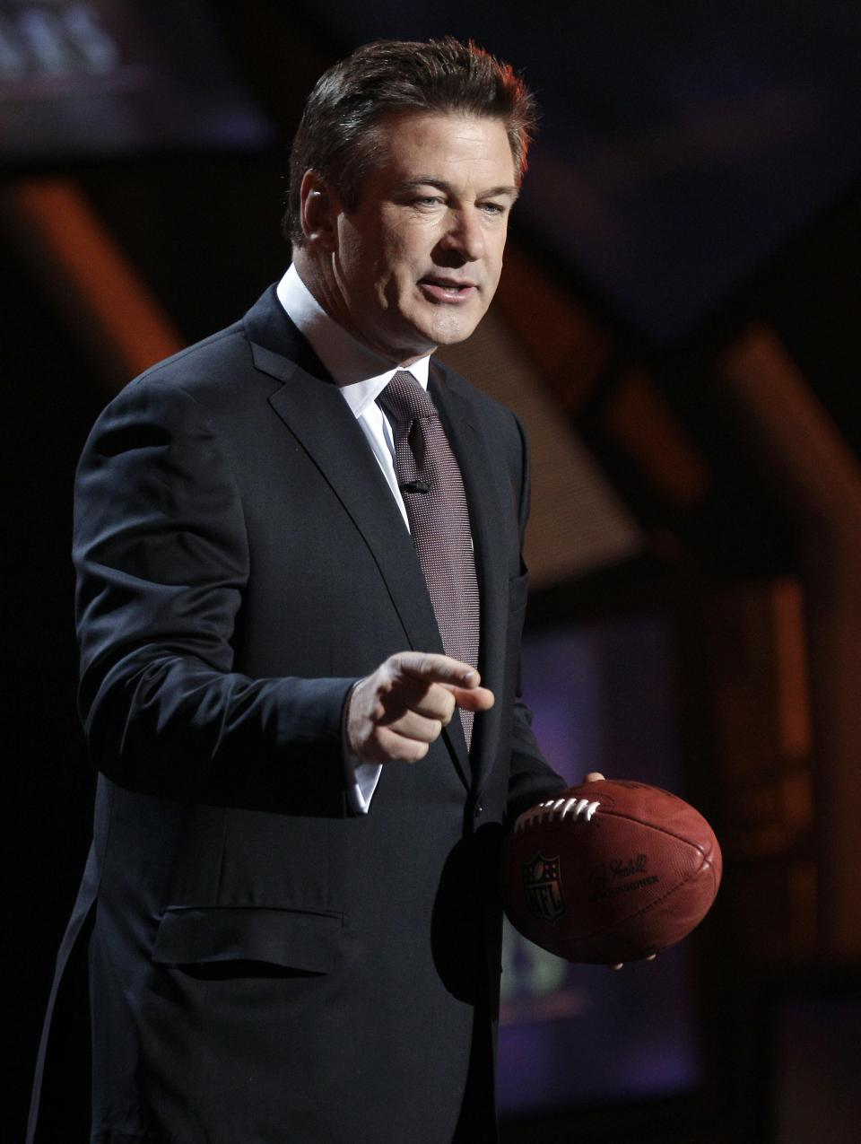 Host Alec Baldwin speaks during the inaugural NFL Honors show Saturday, Feb. 4, 2012, in Indianapolis.The New York Giants will face the New England Patriots in the NFL football's Super Bowl XLVI in Indianapolis on Feb. 5. (AP Photo/Charlie Riedel)