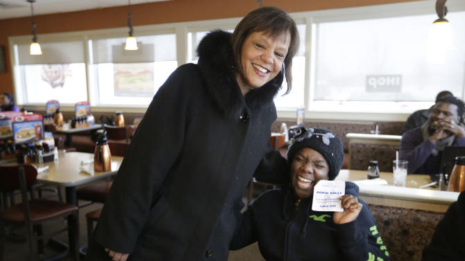 Former Illinois state Rep. Robin Kelly, a Democrat, finds a supporter in Yolanda Stratton as she campaigns at an IHOP in Matteson, Ill., on Tuesday, Feb. 26, 2013, on the final day of the special primary election to replace disgraced former U.S. Rep. Jesse Jackson in Illinois' 2nd Congressional District. Kelly is one of the three front-runners in the primary. (AP Photo/M. Spencer Green)