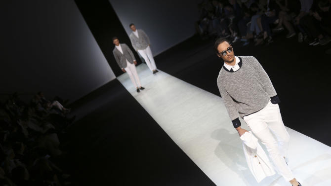 Models wear creations for Giorgio Armani men's Spring-Summer 2014 collection, part of the Milan Fashion Week, unveiled in Milan, Italy, Tuesday, June 25, 2013. (AP Photo/Luca Bruno)