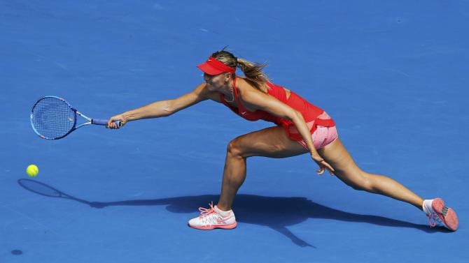 Sharapova of Russia hits a return to Peng of China during their women's singles match at the Australian Open 2015 tennis tournament in Melbourne