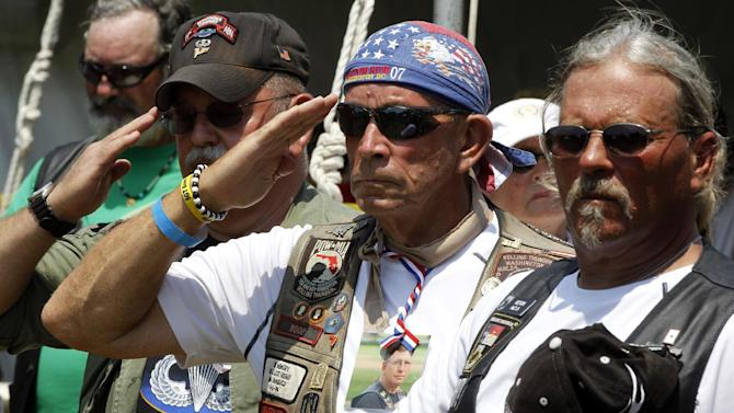 Members of Rolling Thunder salute during the presentation of colors during the annual Rolling Thunder rally on the National Mall ahead of Memorial Day in Washington, Sunday, May 27, 2012. (AP Photo/Charles Dharapak)