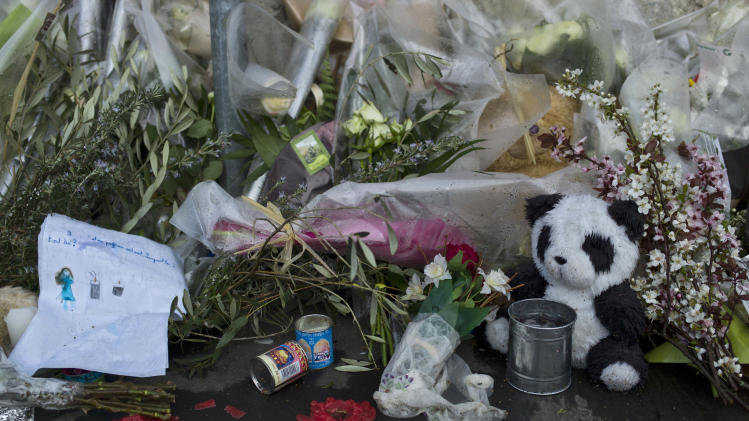 Flowers and a teddy bear are laid outside the Ozar Hatorah Jewish school, in Toulouse, France, Friday March 23, 2012 after three children and a rabbi gunned down on Monday. Inspired by radical Islam and trained in Afghanistan, the gunman methodically killed French schoolchildren, a rabbi and paratroopers and faced down hundreds of police for 32 hours. Then he leapt out a window as he rained down gunfire and was fatally shot in the head. (AP Photo/Thibault Camus)