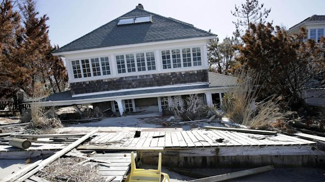 A home rests along Barnegat Bay, Thursday, April 25, 2013, in Mantoloking, N.J., after it was severely damaged last October by Superstorm Sandy. Six months after Sandy devastated the Jersey shore and New York City and pounded coastal areas of New England, the region is dealing with a slow and frustrating, yet often hopeful, recovery. (AP Photo/Mel Evans)