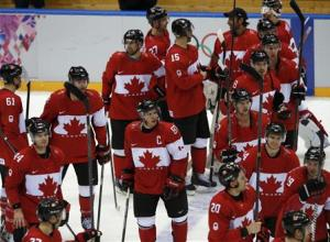 Canada's Sidney Crosby and his teammates salute the fans after defeating Norway in their men's preliminary round ice hockey game at the 2014 Sochi Winter Olympic Games