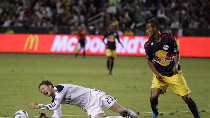 Los Angeles Galaxy midfielder David Beckham, left, of England, is fouled by New York Red Bulls defender Roy Miller during the second half of the second game of an MLS soccer Western Conference semifinal at Home Depot Center in Carson, Calif., Thursday, Nov. 3, 2011. (AP Photo/Jae Hong)