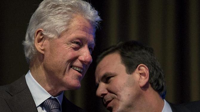 Former President Bill Clinton listens to Rio de Janiero Mayor Eduardo Paes at the Clinton Global Initiative (CGI) Mid-Year Meeting Monday, May 6, 2013 in New York.Details for CGI Latin America and a new commitment from the C40 Climate Leadership Group in partnership with the Clinton Foundation were announced at the event. (AP Photo/Craig Ruttle)