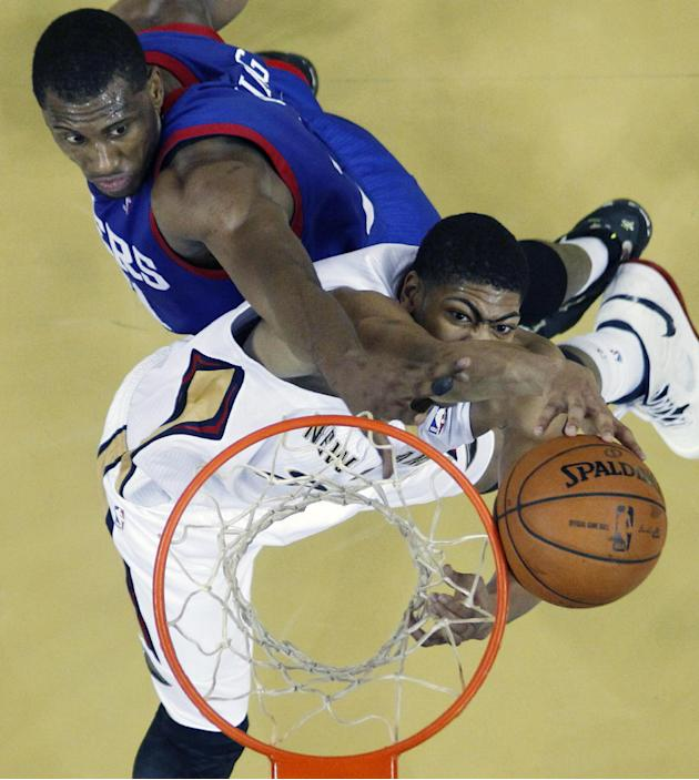 New Orleans Pelicans power forward Anthony Davis battles for a rebound against Philadelphia 76ers power forward Thaddeus Young, top left, in the first half of an NBA basketball game in New Orleans, Sa