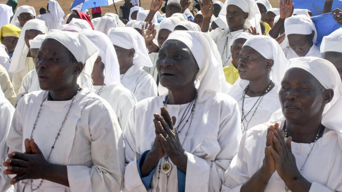 Members of the Legio Maria religious movement pray for a peaceful election in Kisumu, Kenya Sunday, March 3, 2013. Clerics across Kenya gave sermons dedicated to peace on Sunday the day before a national election that some fear could descend into the same violence that engulfed the East African country after the disputed 2007 election. (AP Photo)