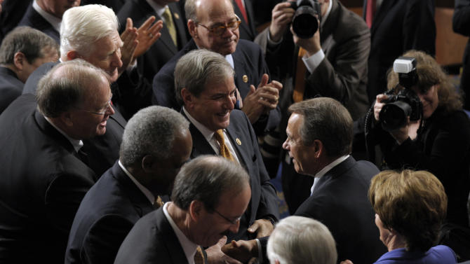 House Speaker John Boehner of Ohio, center, followed by House Minority Leader Nancy Pelosi of Calif., shakes hands as they walk into the House of Representatives chamber on Capitol Hill in Washington, Thursday, Jan. 3, 2013, after they were re-elected in their current titles for the 113th Congress3. (AP Photo/Susan Walsh)