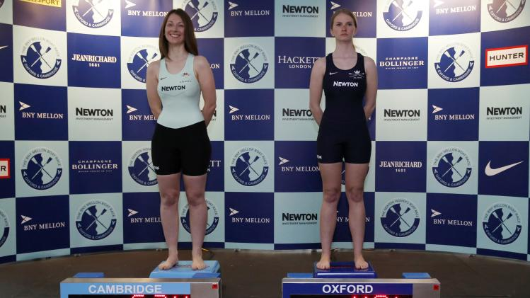 Cambridge and Oxford women's crew coxes are weighed during a news conference in London